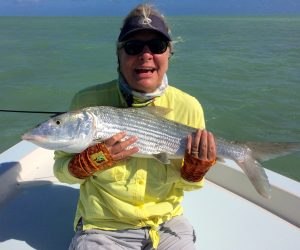 Fran smiles with her 12b bonefish caught on 8lb test mono