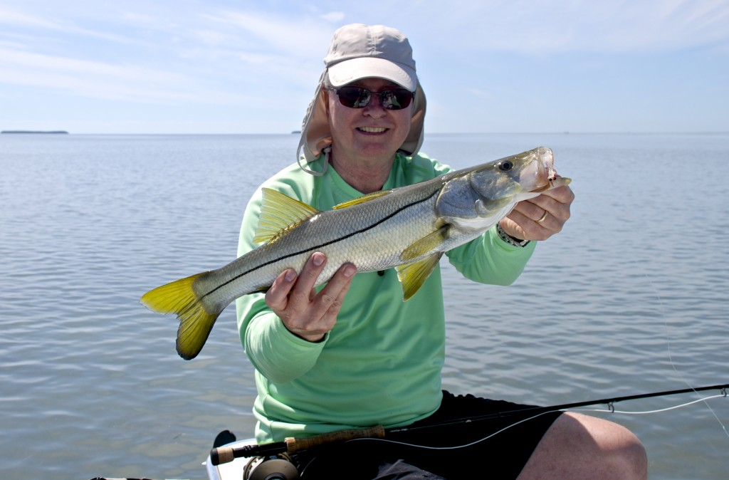 Not bad for his first snook caught on fly March 9th. Look at those electric yellow fins!