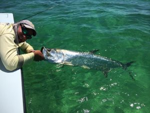 Sam Kaufman reeled in this impressive silver king after hooking it on fly.
